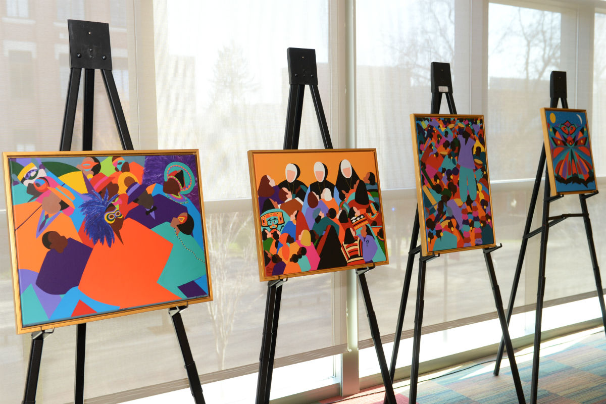 brightly colored paintings on easels