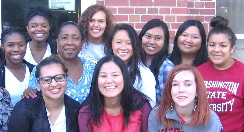 a diverse group of smiling women