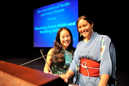 two asian women giving a presentation